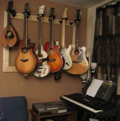 @Brian Fox here is a nice idea for a guitar rack. More surface area = less likely to come crashing down?