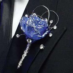 Blue and silver boutonniere    Keywords: #royalblueweddings…