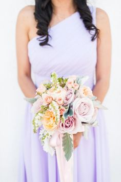Lilac hued bridesmaid dress + bouquet: http://www.stylemepretty.com/california-weddings/pleasanton/2015/12/04/whimsical-starry-nights-inspired-wedding/ | Photography: Candice Benjamin - http://www.candicebenjamin.com/