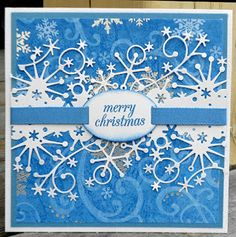A beautiful blue christmas card featuring a Frostyville Border die