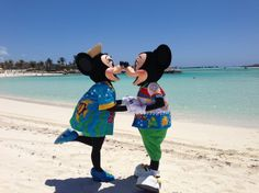 Minnie and Mickey smooch on the beach of Disney Cruise Lines private island, Castaway Cay, Bahamas