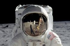 The iconic image of Buzz Aldrin's spacesuit helmet visor will serve as the design for the reverse of commemorative coins recognizing the 50th anniversary of Apollo 11, if Congress approves.