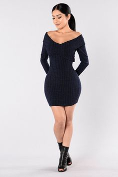 - Available in Navy - Sweater Dress - Off Shoulder - Overlap Front - Long Sleeve - Ribbed - Made in USA - 96% Polyester 4% Spandex