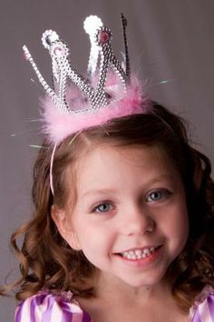 We love this!!  A Princess Crown that stays on with a pink elastic strap.  ThePrincessDress.com