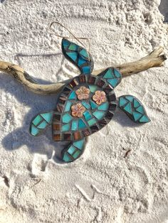 Happy Mothers Day! This beautiful stained glass sea turtle would make a wonderful gift for mom or fellow sea turtle lover!  Celebrate summer! This beautifully handcrafted stained glass mosaic sea turtle decoration was made with care. The sea turtle mosaic features hand cut opaque stained glass, shell beads, and mosaic tile. The glass has been adhered to a sturdy mdf sea turtle I cut with a scroll saw, with acrylic painted sides and back. It has been grouted and sealed. The sea turtle hangs…