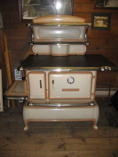 Old Fashion black and gold Range Stove Oven | 1920's Crescent kitchen range. This mint butterscotch enamel range ...
