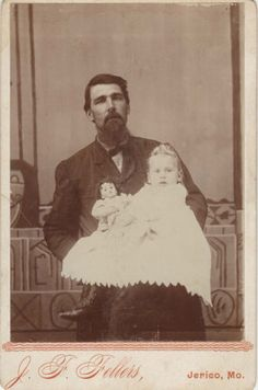 Cabinet-Card-of-a-Father-Holding-His-Daughter-Doll