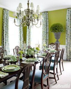Chartreuse is hardly the first color that pops into mind for a dining room (or any other), but paired with quieter, darker greens, it livens things up beautifully. Paint is Benjamin Moore's Grenada Green.