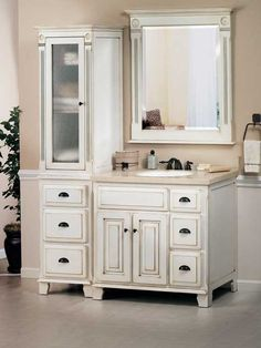 This is an aged Victorian Vanity with an off-white finish. It has cupped bronze hardware that is reminiscent of this fantasized historically period. The white glaze finish is applied by hand and dovetails joints are crafted by skilled woodworkers. Special attention is paid to the small details as the edges of cabinet bevels are stained in a brownish-gold tone to give off the appearance of a heirloom item that's been in the family for ages.