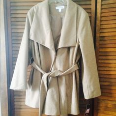 Beige wool coat Adorable coat and super flattering. This coat will fit a few sizes, I am a 2x and the pics show how it fits me. It reads a 4x on the tag. So I would say it ranges from a 2x-4x Pure Energy Jackets & Coats Pea Coats