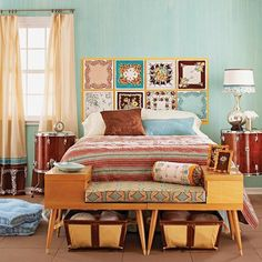 Vintage hankies framed to make a headboard. Love the wood bench at the foot of the bed and the color