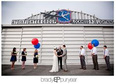 Planes of Fame Museum Wedding   Janice and Tom    weddings    Vintage Dress Red lips Airplane hangar wedding