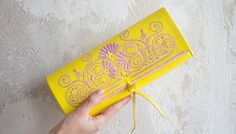Yellow and Rose ABURY Clutch. For every sold product ABURY gives back 10 hours of literacy, numeracy and craft training to the local artisans. Affiliate Partner, Leather Clutch Bags, Handmade Accessories, Fair Trade, Artisan, Black Leather, Numeracy, Morocco, Crafts