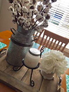 DIY pallet wood serving tray decorated with galvanized tin and cotton stems, farmhouse candle holder, and peonies. I love the all white decor