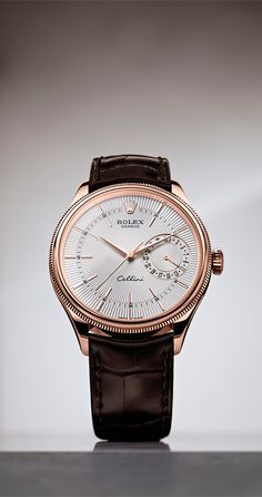 The Cellini Date in 18ct Everose gold, with a silver guilloche dial and brown leather strap.