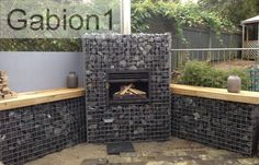 Gabion fireplace - could build something like this to create a heat source for the deck