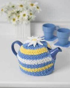 Crochet a cheerful teapot cozy in bright spring colors and a fun crochet daisy on top. This is a quick and easy crochet pattern to perk up your kitchen.  It will also keep your tea nice and warm while you sit and enjoy your new tea pot cozy!