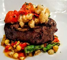 New England Surf & Turf: Filet Medallion, Sweet Corn Succotash, & Lobster Tail with Cherry Tomatoes