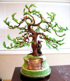 The plaque is made of modeling chocolate as well as the tree The plaque is made of modeling chocolate as well as the tree Nine Thirty lizaselbye modeling chocolate The plaque is nbsp hellip Family Tree Cakes, Fondant Tree, Artisan Cake Company, Tree House Interior, Tree Of Life Artwork, Chocolate Covered Coffee Beans, Chocolate Tree, Italian Hot, Beauty Planet