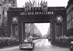 Adolf Hitler on the way to the reception in the City Hall, which was organized for the 15-year anniversary of the NSDAP in Augsburg, 1937.