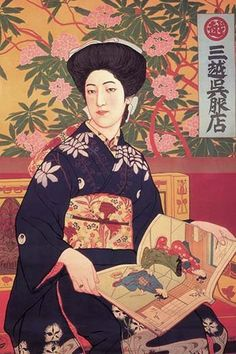 A beautifully dressed woman in a kimono flips through a book of Japanese prints.