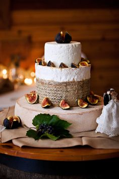 """A #wedding """"cake"""" made of #cheese wheels and garnished with #figs in #CapeBreton #NovaScotia. Love."""
