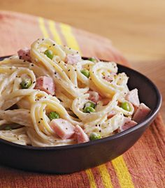 This hearty slow cooked pasta dinner combines ham, linguini and frozen sweet peas with a creamy cheese sauce. If your family doesn't care for Swiss cheese, substitute whipping cream and Gruyère cheese for the half-and-half and Swiss.