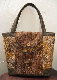 Quilting Digest Page Liked · 13 hrs ·     Love the curved detail on this roomy bag! Get the pattern here: http://quiltingdigest.com/5-lovely-diy-tote-bags-carry-everything-in-style/