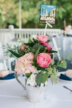 Bright wedding centerpiece idea - pink + greenery floral centerpiece with location table names {Riverland Studios}