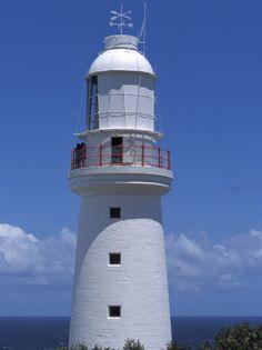 The 1848 Cape Otway Lighthouse Overlooks a Calm Sea Beneath a Blue Sky, Australia  Jason Edwards