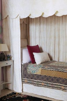 creamy white scalloped bed by Oka