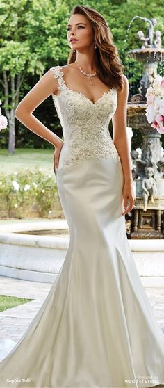 Venus satin fit and flare gown with lace slight cap sleeves, sweetheart neckline, hand-beaded lace appliqué bodice with scattered crystals, softly curved illusion and lace back features zipper trimmed with diamante buttons, court train.