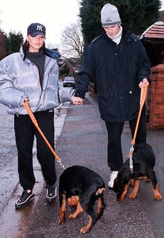 David and Victoria Beckham walking two dogs in 1997