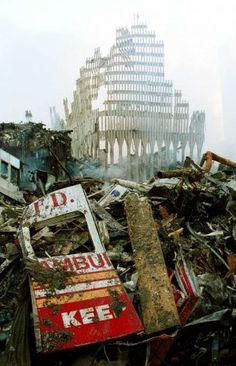 NEW YORK - SEPTEMBER 13, 2001:  Remnants of a New York City Fire Department vehicle lie in the wreckage of the World Trade Center, two days after the twin towers were destroyed after being hit by two hijacked passenger jets,