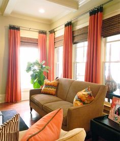 Coral curtain with woven woods.