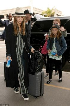 """Step out like Jessica Alba in Opening Ceremony sneakers  Click """"Visit"""" to buy #DailyMail"""