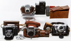 "Lot 380: Camera Assortment; (5) cameras including a Zeiss Ikon ""Super Ikonta"" 532/16 camera with Carl Zeiss Jena 8cm lens, a Sept Paris camera #03942, a Synchro-Compur ""Veriwide 100"" camera with a Schneider-Kreuznach Super Angulon 1:8/47 lens, an Exakta camera with a Carl Zeiss Jena Pancolar 2/50 lens and an Exa Thagee Dresden camera with an E. Ludwig 1061072 Meritar 1:2,9 lens; together with a light meter, leather accessory pouches and lens caps"