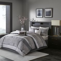 Add a fresh look to your bedroom with the Rhapsody Comforter Set. This woven…