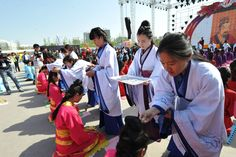 Girls from Taiyuan receive a hairpin to symbolize their place as a woman. This traditional Chinese coming of age ceremony was sponsored by China Yellow River Television and occurred during the 2nd Annual Shanxi Radio and TV Carnival.