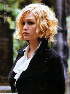 This mid-length wavy, curly bob looked great on Julia Stiles some years back. Julia's round face shape is softened by this hairstyle. This hairstyle works for round faces when styled with a deep side part and soft, long layers.