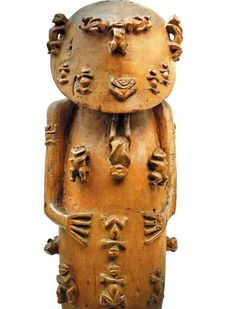 A Polynesian fertility sculpture designed to carry a human skull and bones