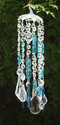 Crystal Palace suncatcher/windchime with 104 vintage chandelier crystals and turquoise stained glass/ fused chimes.