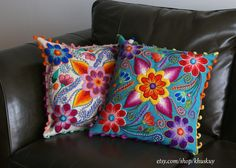 Try vivid colors pillows to lift up a brown leather couch!  Find our embroidered cushions at etsy.com/shop/khuskuy
