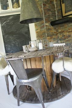 Cable drum table - we will do this for our garden table and use scaffold boards for the top!