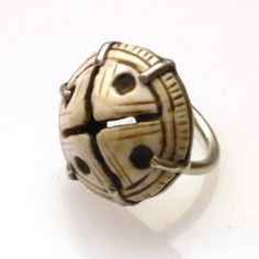 by JewelArts ~ Marrakech Santa Fe   Ring made from a 19th century carved trade shell from Mauritania that was also used as a hair ornament   235$