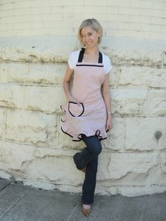 Pink with black dots and heart pocket.  Trimmed in black bias tape. Ruffle around skirt hem.   www.etsy.com/shop/overthetopaprons