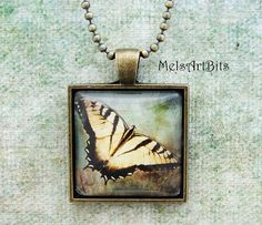 Yellow Monarch Butterfly Teal Blue Background Photo Art Pendant Neckace
