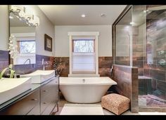 love the color of the tile, and how about that tub, a real soaker it is...