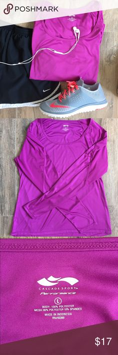 Long Sleeve Workout Shirt Magenta colored workout shirts. Worn twice but never worked out in it . Perfect Condition! Body: 100% polyester Mesh: 90% polyester 10% spandex. Speed Dry. Cascade Performance Brand. Size L non smoking home Tops Tees - Long Sleeve