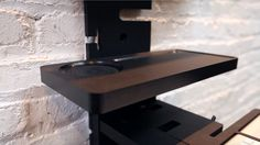 The StandCrafted desk with a small table module in black high-density industrial grade thermo-plastic.